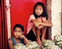 Shopkeeper girls (Aktiv Phil) Tags: girls kids children child lucena vendors shopkeepers