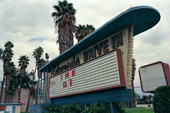 edwards drive in. arcadia, ca. 1996. (eyetwist) Tags: auto california old trees signs building abandoned film car sign architecture analog vintage movie marquee typography gold la losangeles los nikon ruins automobile closed theater neon angeles kodak decay letters 1996 entrance culture screen ishootfilm structure palm gone historic drivein projection socal 400 type americana analogue roadside nikkor boxoffice decaying arcadia typographic doublefeature emulsion cle vanished 8008s f3545 angeleno kodakgold400 nikon8008s eyetwist 2885mm temporarilyclosed nikkor2885mmf3545 ishootkodak scansfromthearchives eyetwistkevinballuff edwardsdrivein signgeeks 4469eliveoakavenue tpori