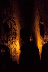 Forward (Marco Perico .) Tags: city light shadow orange dark underground walking person nikon candle tunnel shade napoli naples walls neapolis