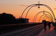 Romantic Walk (flamesworddragon) Tags: southport sunset pier perspective lighting sun clouds orange