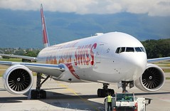 "Pushback""Faces of Swiss"". HB-JNA. Boeing 777-3DE(ER). (Themarcogoon49) Tags: airport swiss aircraft boeing planespotting b777 gva cointrin avgeek b77w hbjna"