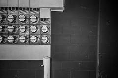 Metered (robert schneider (rolopix)) Tags: metered alameda ca california calif eastbay rolopix robertschneider film monochrome blackandwhite bw kodak trix tx 400tx 35mm ricoh gr1v 28mm flash wall garage meters mundane believeinfilm bwfp autaut