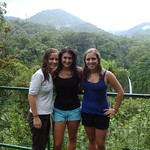 Students pose in a rainforest while studying abroad.