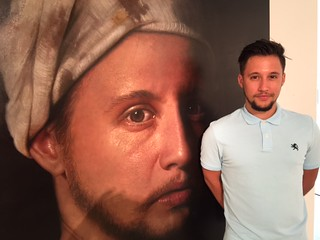 Young Cuban artist Darian with his artwork at the opening at Conde Contemporary gallery in Coral Gables