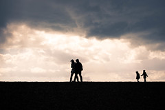 Family Time (gordonsphinx) Tags: family silhouette wind dramatic stormy