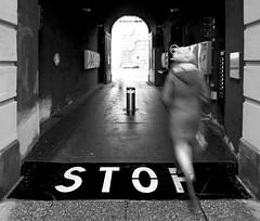 Revolution (C_MC_FL) Tags: vienna wien street blackandwhite bw woman motion blur canon walking person photography eos austria blackwhite movement exposure fotografie streetphotography fast sigma stop mq bewegung sw frau 1020mm 35 museumsquartier gehen bewegungsunschrfe schnell durchgang stereich schwarzweis strase 60d