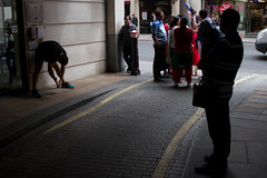 Stretches 2 (bakersam100) Tags: street city shadow streets color colour london up silhouette square lunch photography funny district candid running humour line form athlete financial stretching warming mile jogger limber