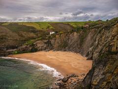 Covachos (Dea) Tags: sea sky beach clouds coast mar spain olympus e3 cantabria mogro arna covachos fola