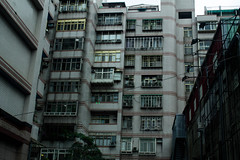 Over-Population (Melissa Boodoo) Tags: world life china city travel pink blue people urban orange plants abstract colour building green window nature lines animals yellow contrast buildings outdoors living globe purple outdoor pastel live indoor structure explore caged southeast minimalism journalism bold concret architure viberant vsco vscocam