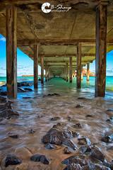Under the Pier (B-Sharp Photography) Tags: oahu hawaii makai pier ocean rocks surf symmetry shore beach landscape hdr