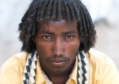 Portrait of an afar tribe man with traditional hairstyle, Afar region, Assayta, Ethiopia (Eric Lafforgue) Tags: africa portrait people color men face horizontal hair outdoors photography day adult african muslim islam culture tribal headshot ethiopia tribe ethnic hairstyle curlyhair adultsonly oneperson frontview traditionalculture hornofafrica individuality ethnology eastafrica abyssinia tribesman realpeople 2025years greatriftvalley lookingatcamera onlymen onemanonly danakil 1people pastoralist asayta afarregion nomadicpeople assaita asaita assayta ethio162506