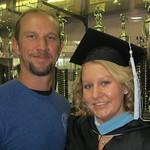 Graduate posing at graduation