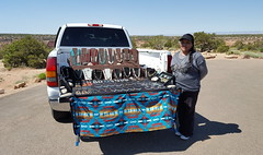 Local Navajo woman selling her jewelry at a lookout point along Canyon Rim drive