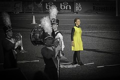 She walks in the sun... (ParadoX_Design) Tags: show music sunlight netherlands girl yellow dance uniform flag contest trumpet nh jb beatrix jong drumcorps dce colorguard huizen squinting dcn