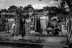 Cuban Market (Ashdon McFall) Tags: trees sky people bw white black women market sale cuba dresses cuban seated selling guardalavaca holguin d3200