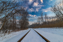 Snow covered tracks (markmapaphotography) Tags: winter sky snow cold clouds train tracks