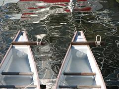 a reflection on dragon boats (Szymek S.) Tags: canada reflection water vancouver boats britishcolumbia canoes falsecreek dragonboats