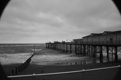 Fish of teignmouth (James Lofty) Tags: sea blackandwhite white black pier fisheye teignmouth drak cloudys