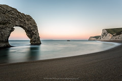 Jurassic (David Ball Landscape Photography) Tags: ocean longexposure greatbritain light sea england sky seascape beach water digital sunrise canon landscape photography dawn coast rocks glow unitedkingdom outdoor tripod shoreline wideangle pebbles location coastal dorset tones iconic jurassic durdledoor 2015 bythesea jurassiccoast leefilters littlestopper davidballlandscapephotography