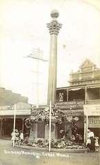 Soldiers Memorial on the Corso, Manly - circa 1920 (Aussie~mobs) Tags: vintage postcard manly australia corso hairdresser shops newsouthwales ww1 stores wreaths warmemorial anzac watchmaker jeweller bootmaker tobacconist soldiersmemorial williamellis starphotocompany gordonadrian