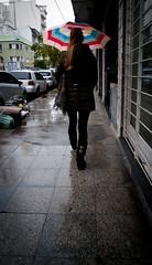Umbrella Walk (Fer Gonzalez 2.8) Tags: street leica woman wet rain lady back legs boots jacket leicadlux4 fullcolourumbrella