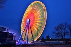 Big wheel (Mettwoosch) Tags: city travel sky lightpainting night canon river germany deutschland eos lights licht cathedral fairground nacht dom cologne himmel kln stadt bigwheel fluss rhine rhein koeln ef kirmes riesenrad lichtmalerei volksfest lichtmalen 5dm3