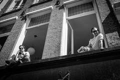 Guys in window @ Amsterdam (PaulHoo) Tags: city people urban blackandwhite bw man holland building men guy window netherlands monochrome amsterdam lumix spring candid citylife streetphotography vignetting vignette 2016 streetcandid