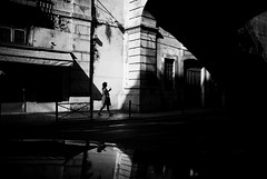 (ajhenriques) Tags: street city windows light people blackandwhite bw woman white abstract black portugal monochrome hat lady contrast digital walking nikon women shadows lisboa lisbon silhouete minimal human d200
