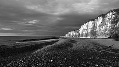 Sea Art (KerKaya) Tags: leica light sunset sea sky bw white seascape black france beach nature clouds landscape lumix coast rocks mood stones horizon nb cliffs panasonic paysage normandy fz200 kerkaya