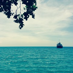 Wanderlust (Grathiael) Tags: blue trees light sea summer vacation sky sun sunlight white house seascape tree green beach nature water leaves clouds rural boats outside boat leaf woods flickr day waves natural bright air cottage sunny serene