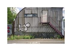 corrugated (ha*voc) Tags: minoltacle minoltarokkor40mmf2 rokkor rangefinder film 35mmfilm fuji160pros urban amsterdam urbanfragments urbandecay urbanentropy corrugation graffiti
