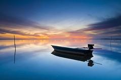 Jubakar (Landscape Junkie) Tags: sunrise reflections boat serenity malaysia goldenhour kelantan sigma1020mm tumpat leefilters nikond90 jubakar landscapejunkie muhamadfaisalibrahim