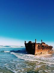 Laying (e.bonomini) Tags: sea sky beach ship australia queensland wreck fraserisland maheno