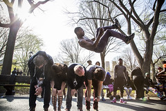 A street acrobat performs a flip over volunteers on the Mall in Central Park (James Prochnik Photography) Tags: nyc newyorkcity centralpark streetshots streetphotography flip buskers acrobat streetphoto gothamist busker unposed streetphotos acrobatic streetshot candidphoto nycstreetphotography nyccolor colorstreetphotography candidphotos newyorkcitystreetphotography manhattanstreetphotography streetacrobat nycstreetshot nycstreetphoto nycstreetphotos nyccandid newyorkcitycandid newyorkcitystreetphotos newyorkcitystreetphoto nycbusker newyorkcitystreetshot unposedstreet nycunposedstreet newyorkcitycolor