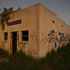 Abandoned Store, Relampago, Texas (Antonio German) Tags: door old cactus southwest color art window overgrown grass america graffiti evening texas pentax lightning pricklypear stucco riograndevalley adandoned rgv relampago