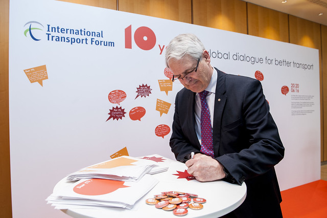 Marc Garneau signs his birthday wishes for ITF