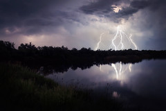 Stormy night (Psztor Andrs) Tags: blue trees light lake storm reflection green reed nature water grass night clouds photography pond nikon hungary shadows power angle flash wide lightning dslr thunder 18mm andras pasztor d5100