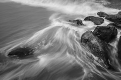 Gooooing Out (Thomas Pohlig) Tags: ocean sea blackandwhite beach water monochrome landscape newjersey sand rocks waves jetty tide jersey series capemaypoint jerseyshore seashore rockpile oceanwaves