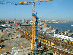 Bouwput Oosterdok in Amsterdam, 2005; view over the construction site near Central Station; geotagged photo by Fons Heijnsbroek (Amsterdam city photos, geotagged) Tags: 2005 city panorama building station amsterdam architecture geotagged photo site construction view outdoor central picture trains pit structure cranes sight overlook traintrack fons oosterdok heijnsbroek
