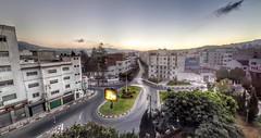 Ghost Town / Iftar Time (Yassine Abbadi) Tags: sunset sky sun building tree grass breakfast circle square town traffic ghost ad morocco maroc ramadan marruecos iftar tetuan trafficcircle tetouan maghrib ftour