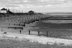 Seasalter view. (pstone646) Tags: beach shore nature sea shingle kent monochrome blackandwhite seasalter buildings boats breakwaters sky clouds