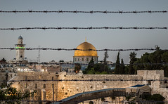 jerusalem protected (iMagdes) Tags: israel war conflict islam wall jerusalem muslim western mount kotel palestine fight stone flag rock mosque peace barbed middle worship history occupation jewish east process old minaret dome faith division dispute gold city temple haram sky religion alsharif ancient prayer military barbedwire wire fence security protection boundary spiked dusk