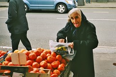 Busted with satsumas (deepstoat) Tags: orange london film tongue zeiss 35mm contaxt3 peckham wellthattoldme