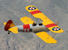 N63555 Flyby (John W Olafson) Tags: boeing warbird biplane stearman palmspringsairmuseum triplenickel kaydet n2s3 kpsp n65333