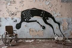 Cradle to the grave (Kriegaffe 9) Tags: italy hospital graffiti peeling decay wheelchair asylum pram