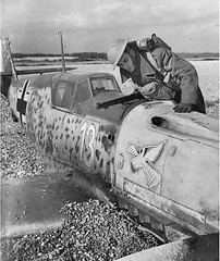 An English soldier inspects a crashed Messerschmitt Bf-109.
