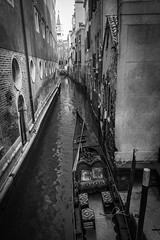 Lonely (SLpixeLS) Tags: venice italy white black canal italia noir gondola et venise venezia vignette blanc italie canale gondole