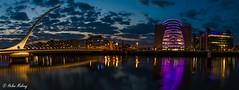 Dublin 12May16 1 (Helen Mulvey) Tags: longexposure bridge sky panorama water architecture night clouds river movement lowlight cityscape outdoor riverliffey cloudmovement samuelbeckettbridge