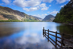 Buttermere ( Ian Flanagan) Tags: trees light sun lake reflection clouds fence district thelakes