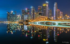 City Reflections (Leslie Hui) Tags: reflection singapore cityscape bluehour centralbusinessdistrict marinabay panoromic singaporefinancialdistrict